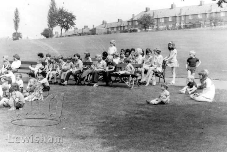 Children Watching Punch & Judy, In The Playing Fields by Durham Hill and Moorside Road on the Downham Estate near Bromley Kent England in 1972