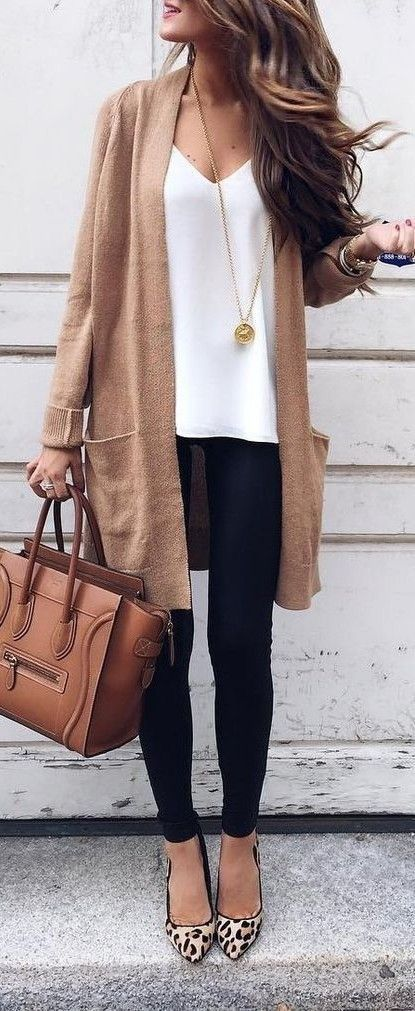 Love the white top, nice cut and deep neck, love the sweater. Long necklace is pretty too.
