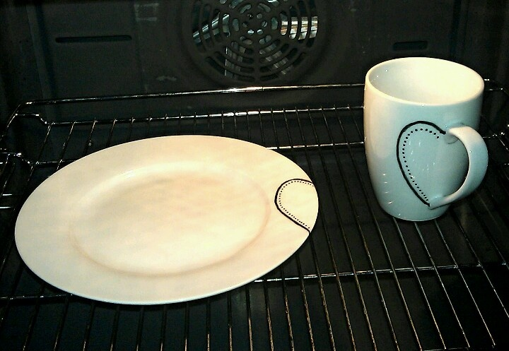 Mug and plate with half a heart, just finished in the oven.