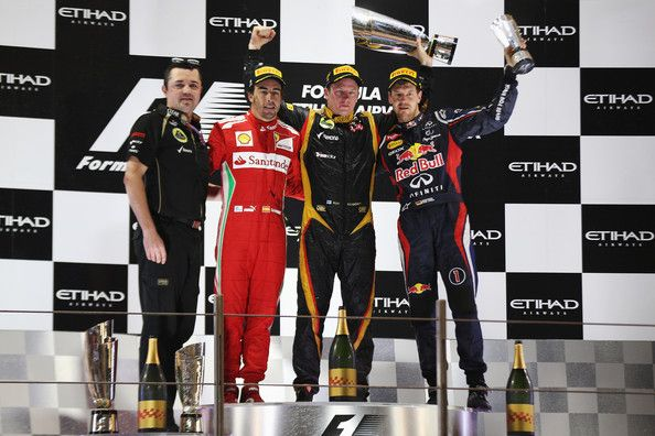 Race winner Kimi Raikkonen (2nd right) of Finland and Lotus celebrates on the podium with second placed Fernando Alonso (2nd left) of Spain and Ferrari, third placed Sebastian Vettel (right) of Germany and Red Bull Racing and Lotus Team Principal Eric Boullier (left) following the Abu Dhabi Formula One Grand Prix