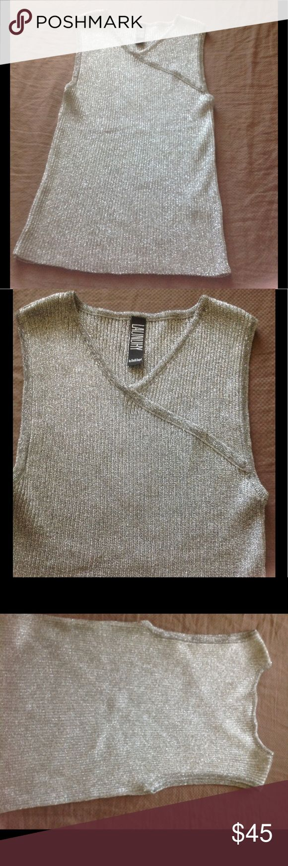 Stunning Silver Laundry Blouse This is a beautiful stunning silver blouse by LAUNDRY I  purchased this top with a gorgeous skirt I have listed as well from Newman Marcus - Perfect outfit. You will love the cut/style of this Blouse! 👀👀👀have so much to list due to domestic violence and now being homeless. Please don't hesitate to make offer I have been given so much time for Storage before I lose everything. Some items will be sent away to consignment but very few. PLEASE LOOK AND SPREAD…