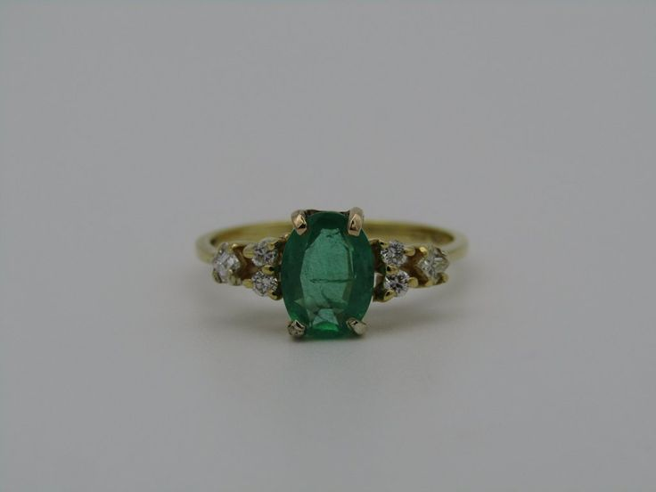 18kt gold emerald and diamond ring.