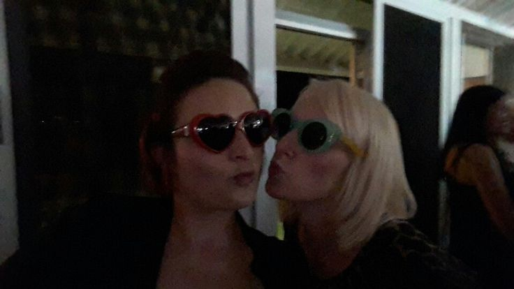 Sisters wearing silly sunnies