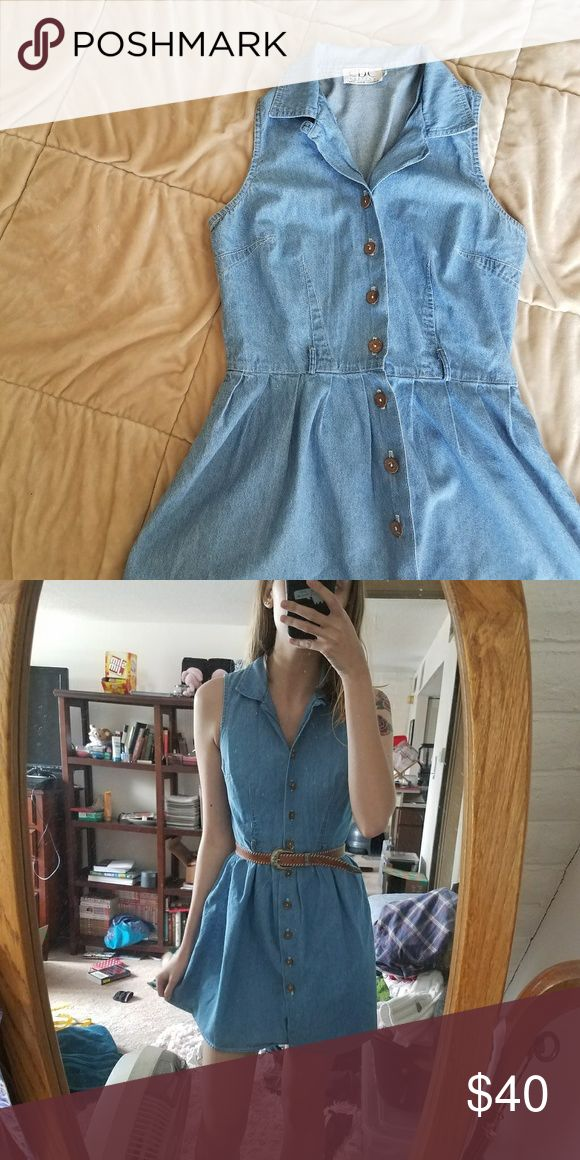 "Vintage denim dress Really adorable vintage denim dress. This babe is so cute. Sleeveless and a button up front. Size tag is 4 petite. Best for extra small/small. I have a 25"" waist and would not recommend much larger. I would recommend for a shorter person just in terms of the length and shoulder width. I am 5'8"" and the shoulders were a bit tight (I ain't petite I guess haha). Vintage Dresses Mini"
