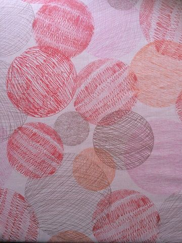 100% cotton voile in beautiful pink with circles and squiggles. Such beautiful light summer fabric - ready to buy and create with.