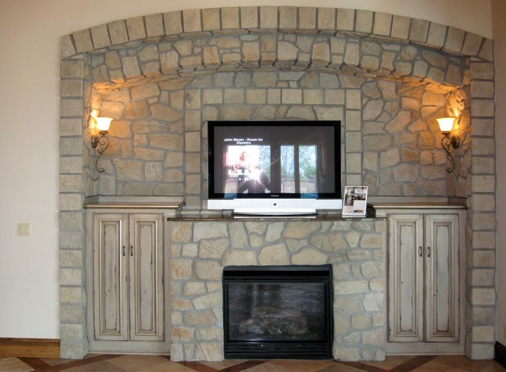 fieldstone fireplace wall - arch + cabinet added to recessed area each side of kit + side lights