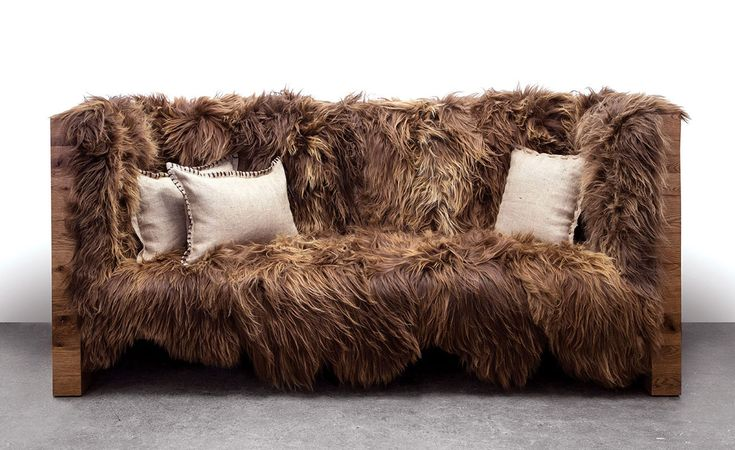 "Designed by Nersi Nassen, the sofa is made with reclaimed Oak (white and/or red), Icelandic Lamb Wool, pocket springs, two layers of foam and one layer of Dacron. The sofa is 96""Lx42""Dx40""H and because the wool and the Oak are filled with variables, no two sofas are exactly the same. - found on trendir.com"