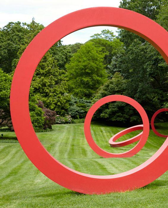 """The sculpture """"Rings"""" (2005) by Zhu Jinshi in the garden of Lisa and Richard Perry."""