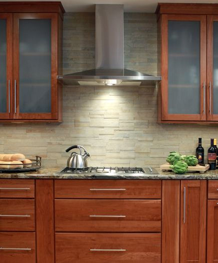A Porcelain Ledgestone Tile Provides A Durable But Stunning Backsplash For This Cooking Area Cabinets