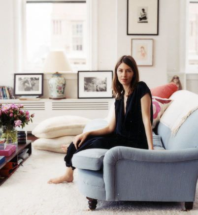 Sofia Coppola in her Living Room - like idea on top of radiator cover. Love this!