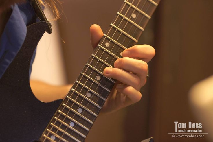 Student of Tom Hess practicing guitar exercises.
