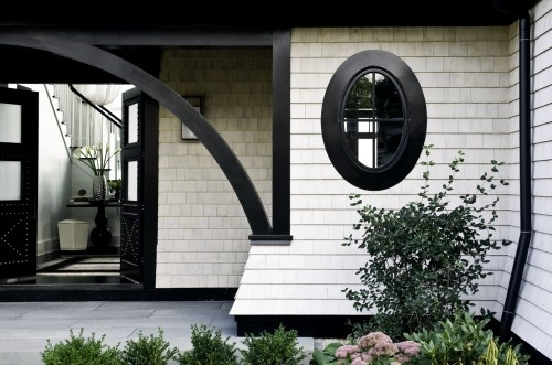 Bold gestures and oversized elements, especially at the entrance and porches, add to a Shingle-style home's grandness.