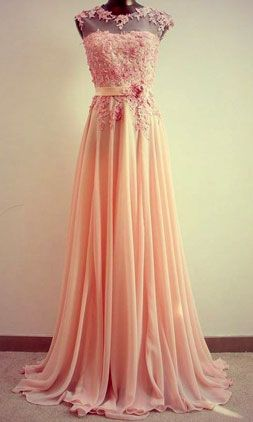 Get inspired: This beautiful peach bridesmaid gown adds a fresh, juicy twist to the big day!