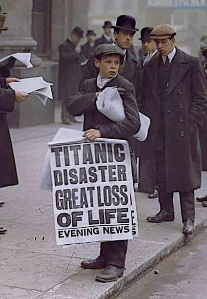 Colorized photo of Ned Parfett, best known as the 'Titanic paperboy' with news of the disaster outside the White Star Line offices at Oceanic House on Cockspur Street near Trafalgar Square in London SW1, April 16,