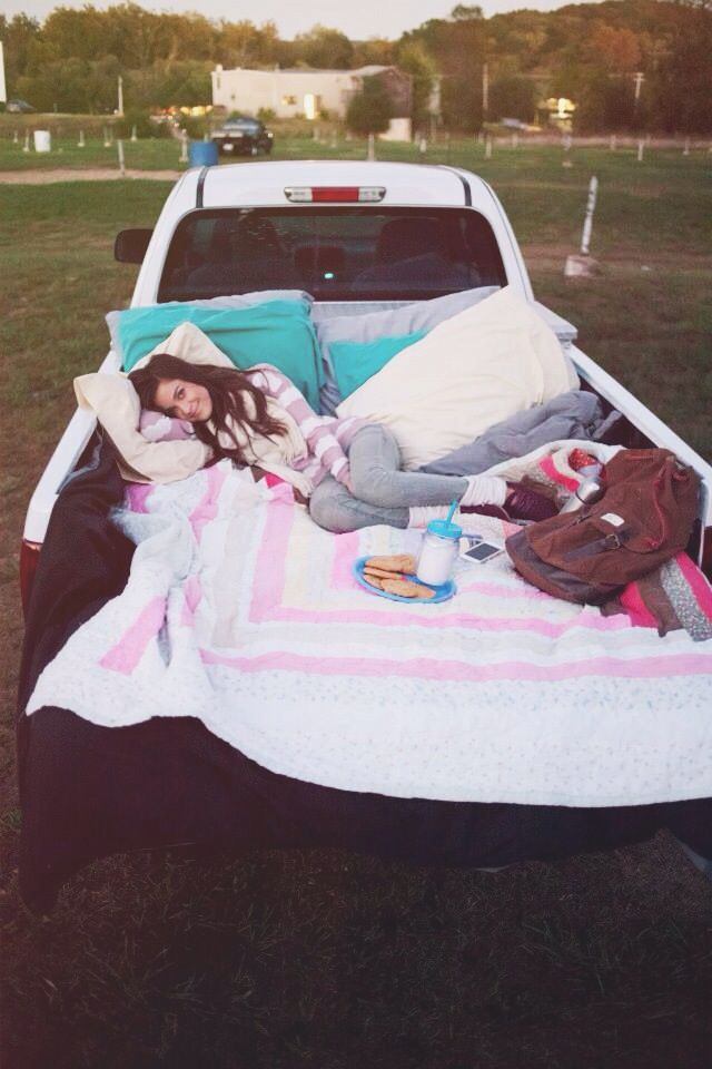 a night at the drive in movie theatre. We took his truck and he threw blankets and pillows in the back and packed chai tea and pbjs and cookies. Cute date night ideas. Anniversary date night. Cami wade photography