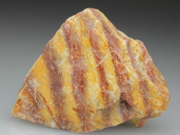 LITHOMARGE: Cook's Kitchen Mine, Camborne, Cornwall. 'A rare type of curiosity. This specimen of Lithomarge displays the layered deposition of the waxy lustred clay mineral alternating between iron rich red layers and yellowish iron poor.' ✫ღ⊰n