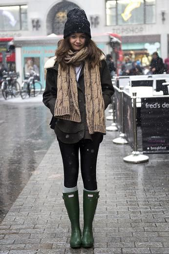 London v Paris in the snow  LONDON: Lena Wellenhofer, 20, student. Hat, ASOS; scarf, Kenzo; coat, The Kooples; boots, Hunter