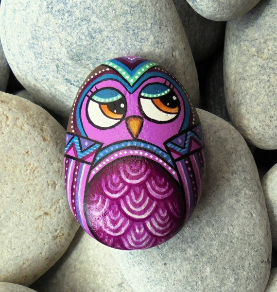 Hand Painted Owl Rock !  A great handmade painted stone from me!    Is painted on a smooth sea stone which i have collected from a beach on the