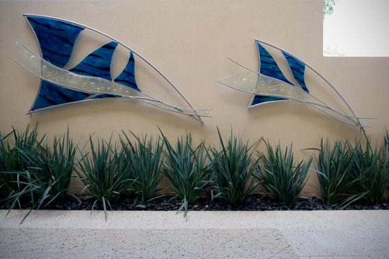glass and stainless steel sails by Tavoli