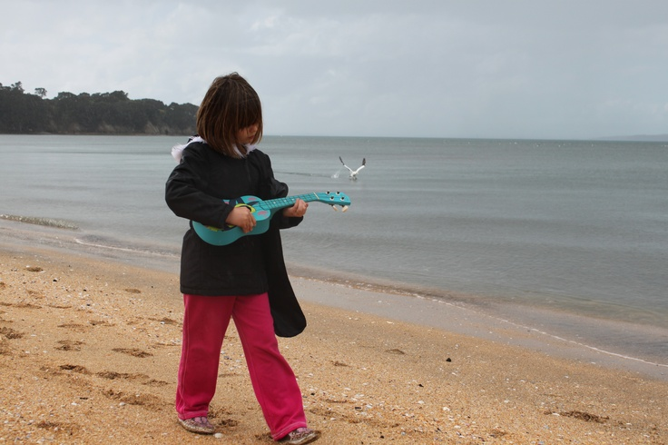 My daughter Violet playing the Uke along the beach