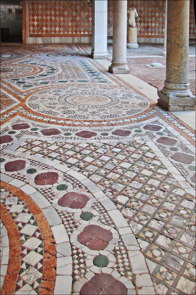 The courtyard of the Ca d'Oro in Venice is paved with intricate mosaics.