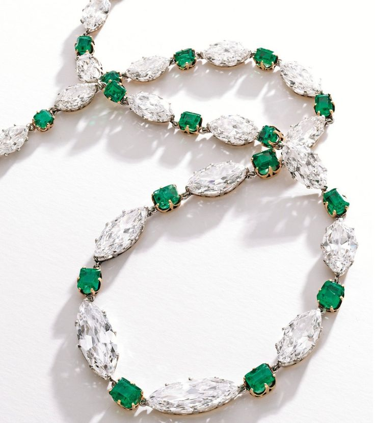 PLATINUM, GOLD, DIAMOND AND EMERALD NECKLACE Set at the front with 18 marquise-shaped diamonds weighing approx 47.00 carats, spaced by 18 emerald-cut emeralds weighing approx 11.00 carats, length 17 inches; circa 1910.