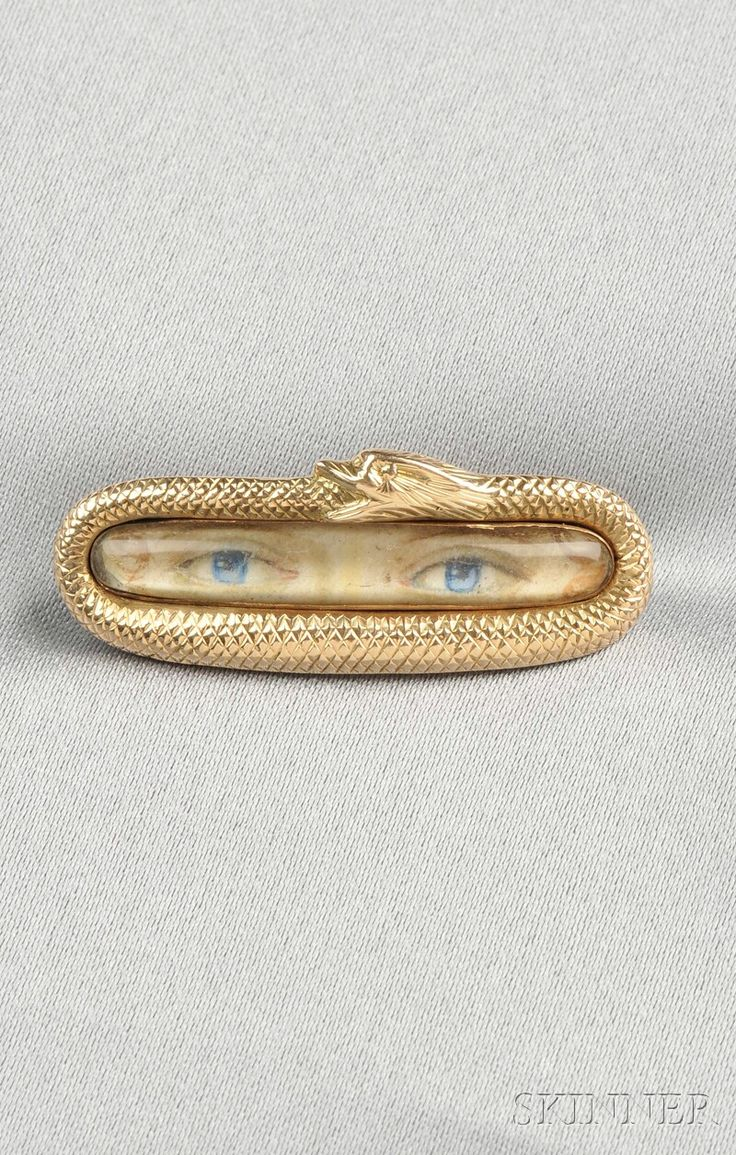 "Antique ""Lover's Eye"" Brooch, depicting a pair of blue eyes within a gold frame designed as a serpent swallowing its tail, lg. 1 3/8 in. Georgian or Georgian style"