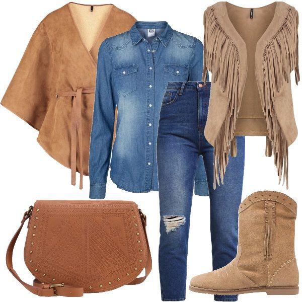Frange color camel e jeans per questo look western. La camicia in jeans viene avvolta da uno smanicato ricco di frange e da una mantella calda. Lo stivaletto basso vi permetterà di essere pratiche e comode per tutto il giorno.