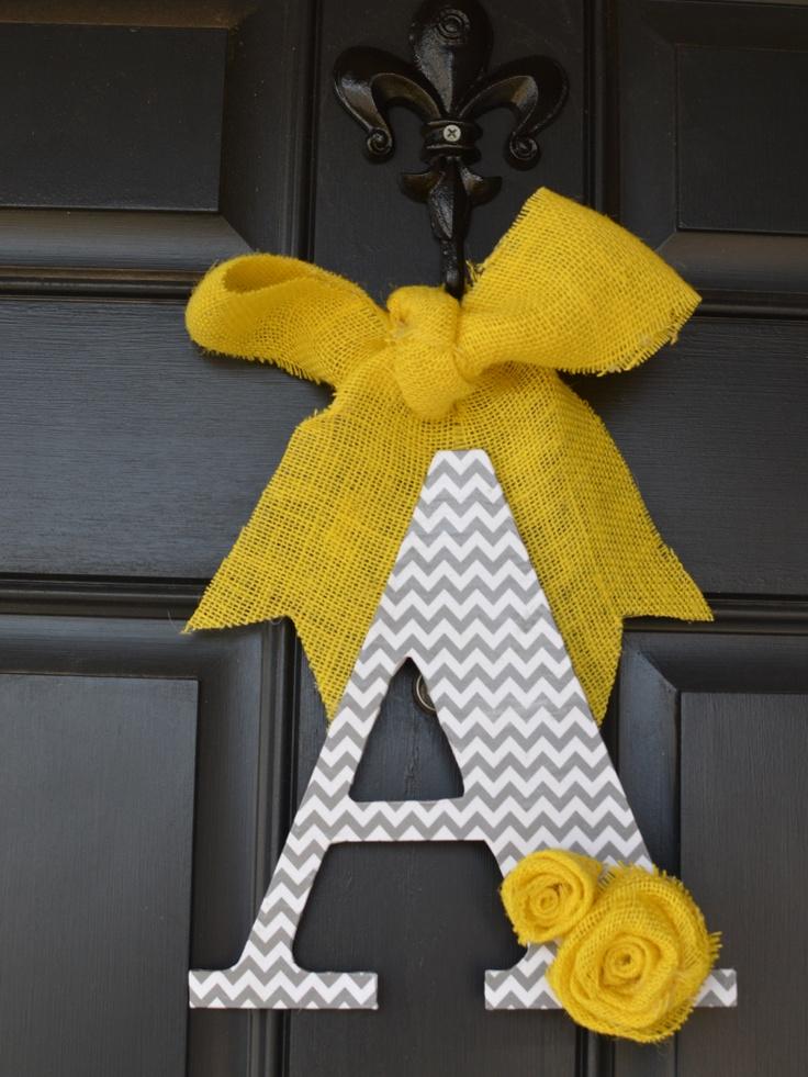 Grey chevron print door hanger with a yellow burlap bow.