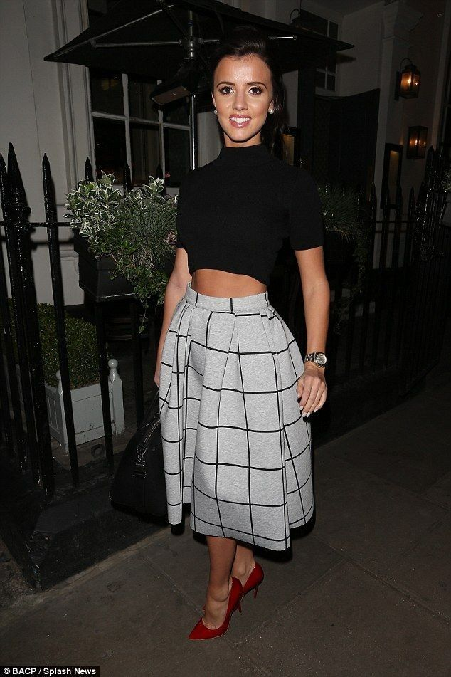 Lucy Mecklenburgh.. black high-neck crop, Topshop grid print bonded midi skirt, and red patent heels..... - Celebrity Fashion Trends