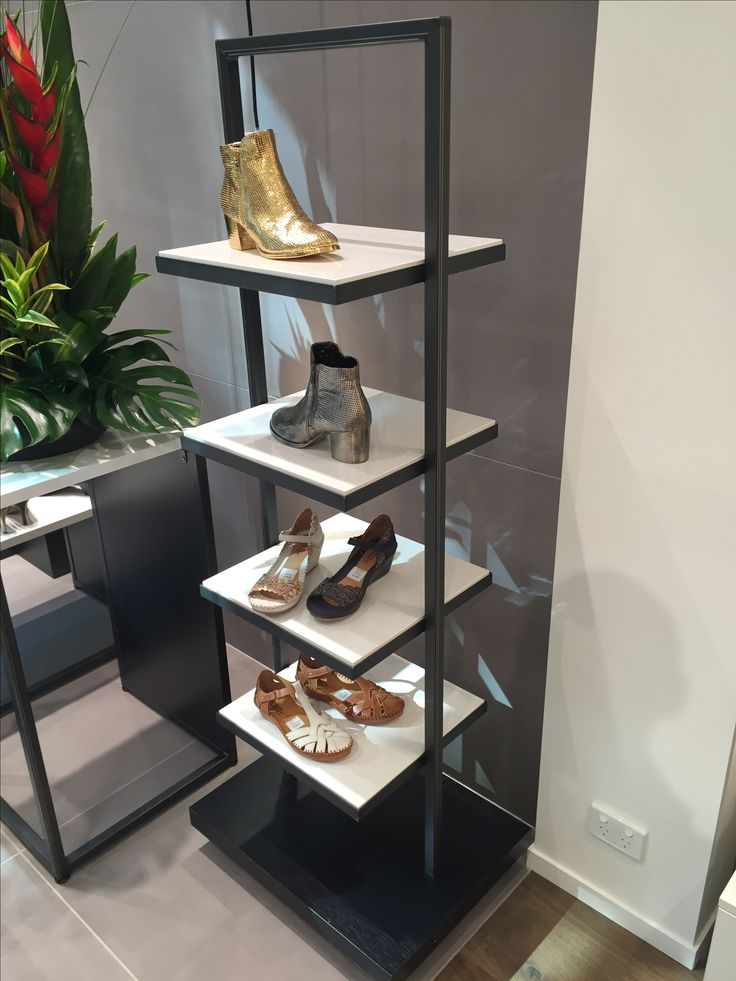 A combination of timber and metal shoe display stand for Mountfords