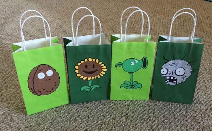 Plants vs Zombies Goody Bags: Easy to make just cut out of construction paper, draw on faces and outline with a marker, then glue on bags.
