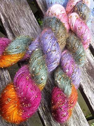 Beaded Mohair with sequins  This amazing colorway is one we refer to as Candyland - the blend from lovely oranges and pinks to blues and greens are an amazing achievement - not a muddy color in site. 80% Silk/20% kid mohair with glass beads and sequins