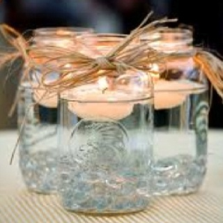 Wedding Centerpiece ideas...I really like these a lot...maybe with pumpkins or something?
