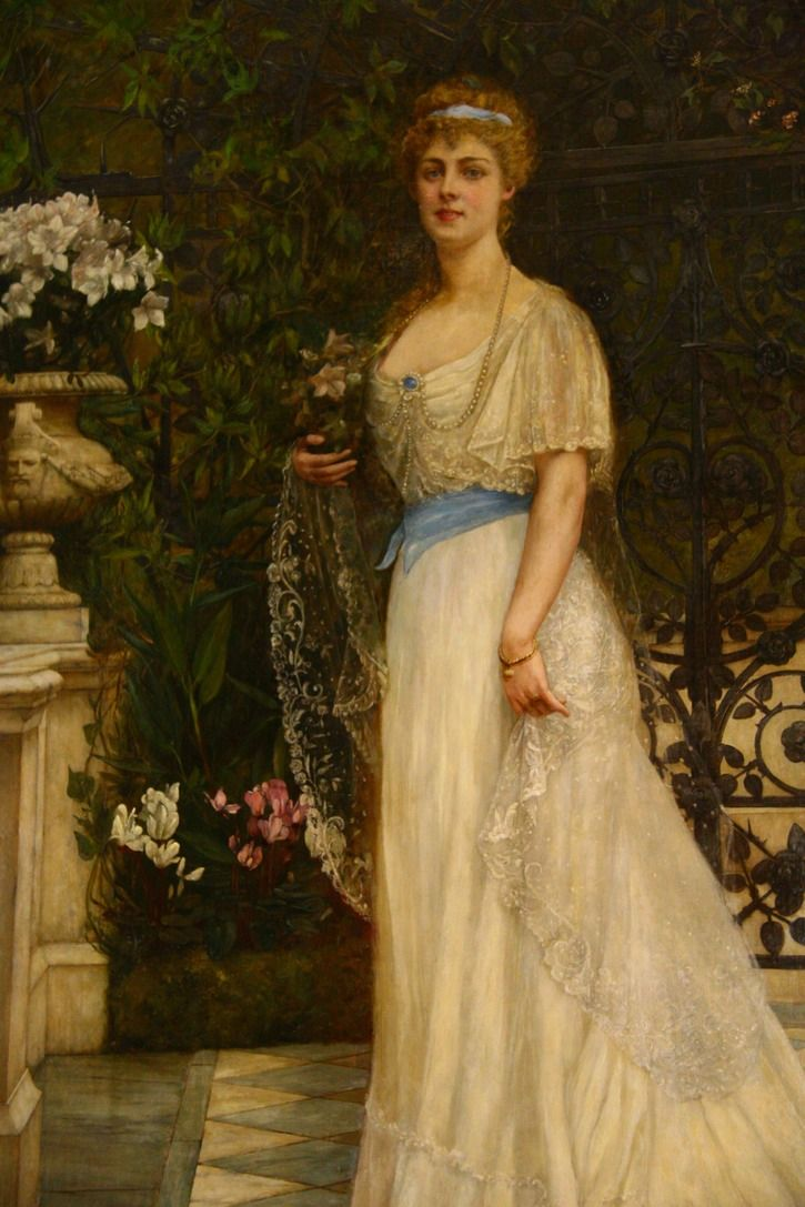 Princess Daisy of Pless wears a 1900s dress with a shallow V waistline that looks like a vest's bottom and a hint of a blouson bodice in this portrait