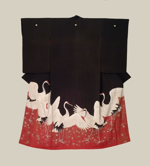 I wonder if this is a wedding kimono, because of the presence of cranes, a symbol for good luck.
