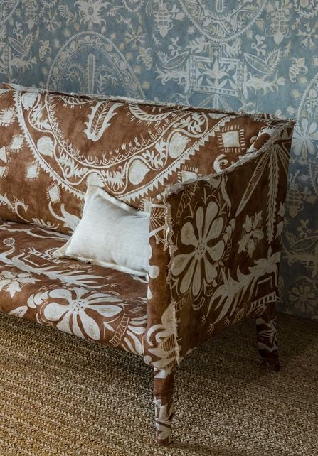 Lewis & Wood Womad linen print on sofa and wallpaper