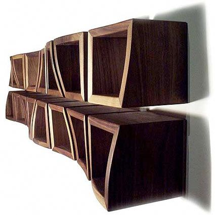 The Procontra shelving system by Sascha Akkermann. Made out of walnut or oak.