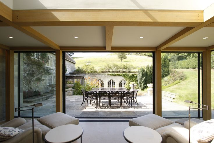 Minimal Windows Sliding Doors Bi Parting To Open Position As Access To Patio  Area From Glazed
