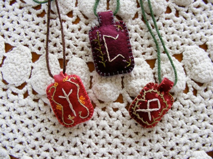 Embroidered rune necklaces.  Could make as pouches and fill with items related to need of spell/ritual.
