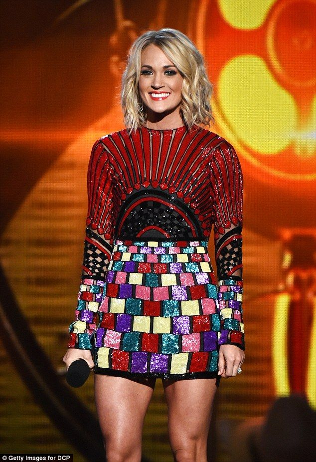 Carrie Underwood at The 3rd Annual American Country Countdown Awards held at The Forum in Inglewood, Calif (Sun May 1, 2016)   Dress (Elie Madi), Shoes (Giuseppe Zanotti)   Carrie presented the award for Male Vocalist of the Year wearing in a black and red long sleeve top and multi-coloured pattered mini skirt with strappy black patent leather stilettos   Hot stuff: The yummy mummy looked fantastic in the dazzling ensemble while her locks were styled into light waves