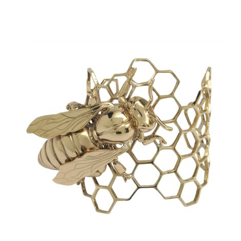 A bronze honeycomb-and-bee cuff by Bernard Delettrez; the bee is a symbol of productive industry. (Monnier Frères)