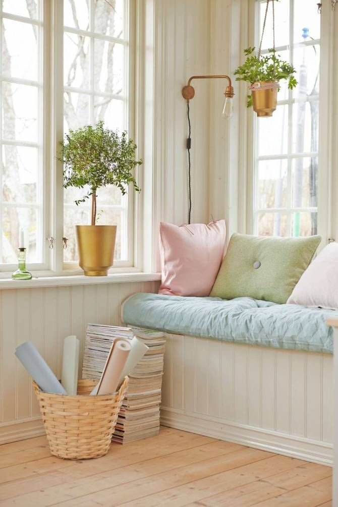 window seat with soft color, natural woods and white background.