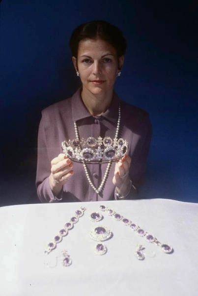 The Swedish Amethyst Tiara was a necklace when Queen Silvia married into the family in 1976. Featuring large oval amethysts surrounded by diamonds & separated by diamond elements in the French Empire style, it was a cumbersome piece. Silvia noted in the documentary De Kongelige Juveler, it was heavy & uncomfortable to wear. So she had a tiara made by adding the necklace to a frame, solving the problem of a too-heavy necklace & filling the absence of an amethyst tiara in the royal collection.