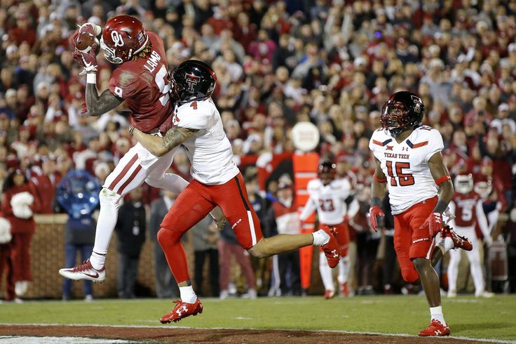 Oklahoma's CeeDee Lamb (9) catches a touchdown pass in front of Texas Tech's Justin Stockton (4) and Thomas Leggett (16) during a college football game between the Oklahoma Sooners (OU) and the University of Texas Tech Red Raiders (TTU) at Gaylord Family-Oklahoma Memorial Stadium in Norman, Okla., Saturday, Oct. 28, 2017. Photo by Bryan Terry, The Oklahoman