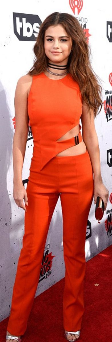 Selena Gomez: Jumpsuit – Mugler  Purse – Jimmy Choo  shoes – Giuseppe Zanotti  Jewelry – Fenton Fallon