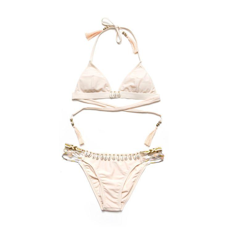 HIPANEMA bikini is composed of a multitude of Brazilian bracelets the links are…