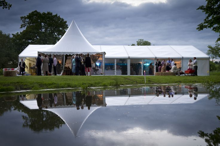 CrackerJack external frame marquee with pagoda entrance and clear window walls