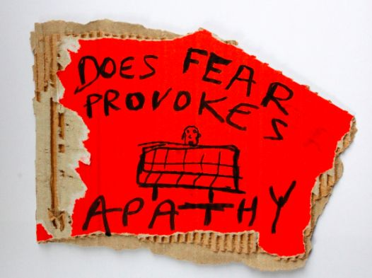 Does fear provoke apathy, black marker text and drawing on carton, 21 x 18 cm