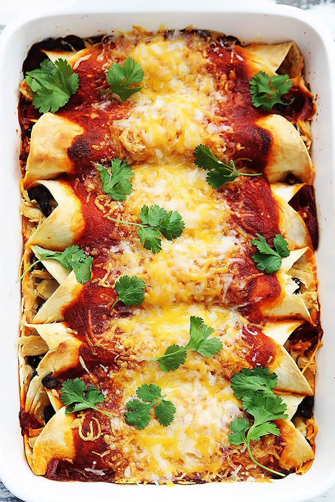 Easy cheesy turkey and black bean enchiladas! Perfect for using up leftover turkey!